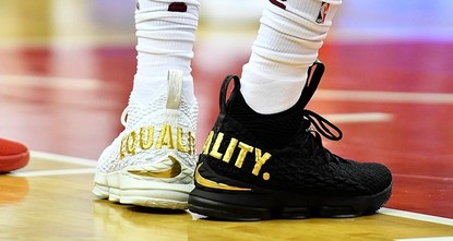 pLeBron James made a statement during an NBA game with his shoes — one black, one white, with the word equality in capital gold letters on the back of each./p  pThen, after the game, James...