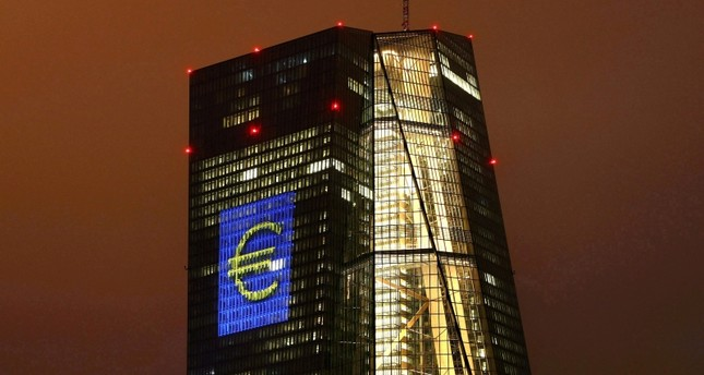 The headquarters of the European Central Bank (ECB) are illuminated with a giant euro sign in Frankfurt, Germany, March 12, 2016. (Reuters Photo)