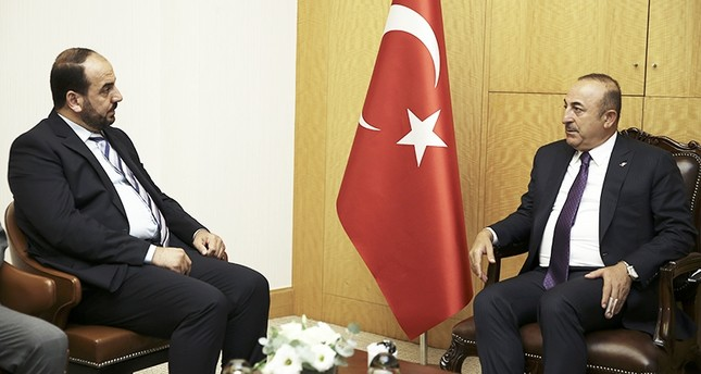 Foreign Minister Mevlüt Çavuşoğlu meets with Nasr Al-Hariri, president of Syrian Negotiations Commission, in Istanbul on Aug. 31, 2018. (AA Photo)