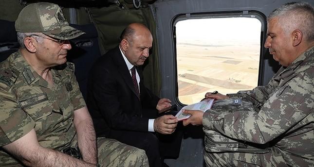 National Defense Minister Fikri Işık (C) visiting Mardin (AA Photo)