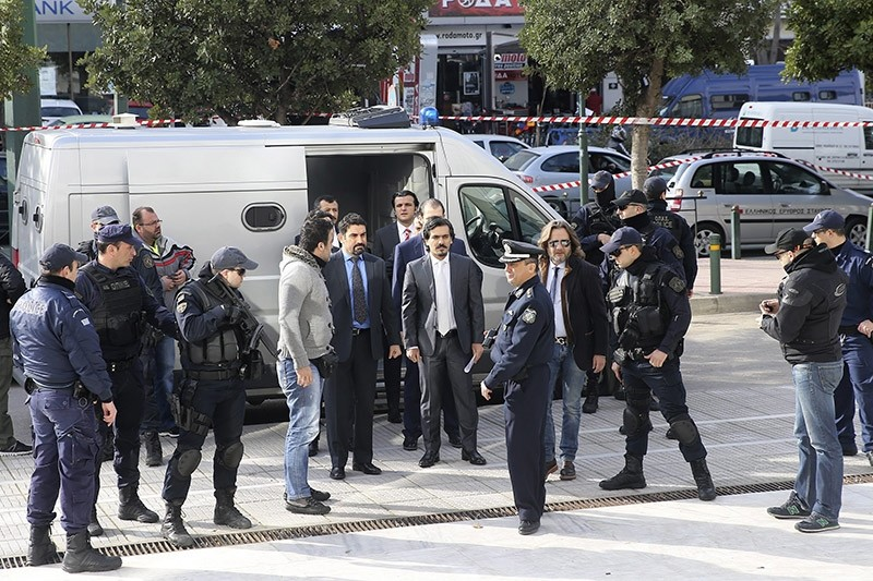 FETu00d6 coup soldiers center, escorted by Greek police officers, arrive at the Supreme Court in Athens,Thursday, Jan. 24, 2017 (AA File Photo)