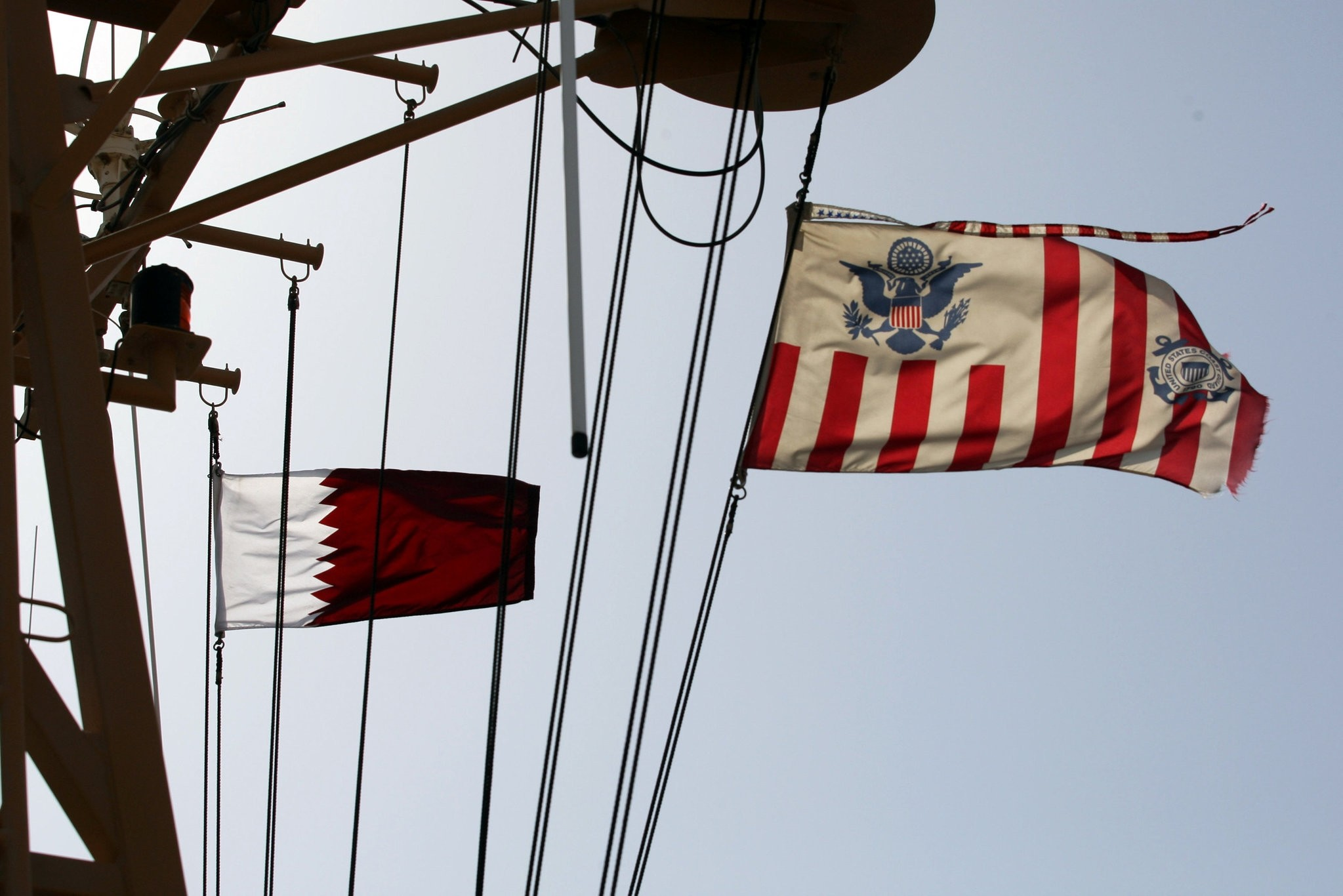 Qatari and a U.S. Coast Guard flags flutter during a joint naval exercise by the U.S. and Qatar troops in the Gulf region, June 16.