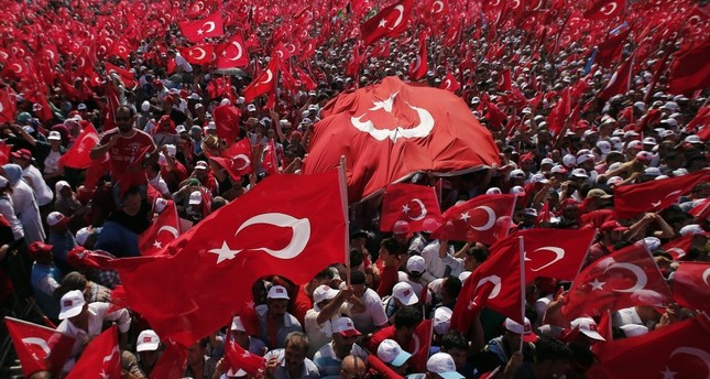 People waving flags during a democracy rally to protest the failed July 15 coup attempt that killed 240 people including civilians, police officers and soldiers, Aug. 7, Istanbul.