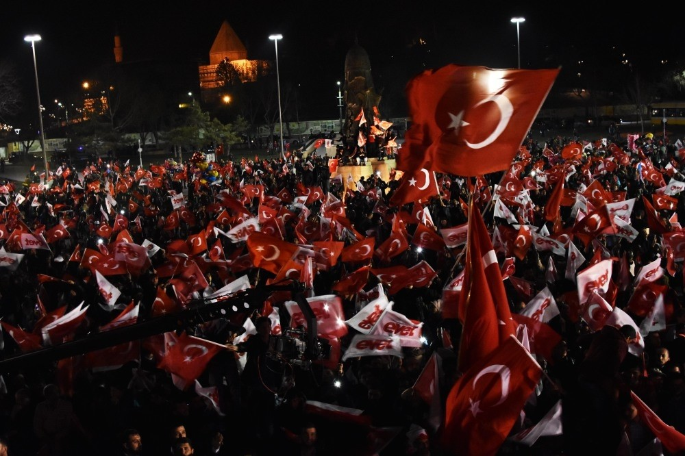 People gathering to celebrate Turkey's Sunday referendum's results, which will change the parliamentary system to a presidential one in Konya.