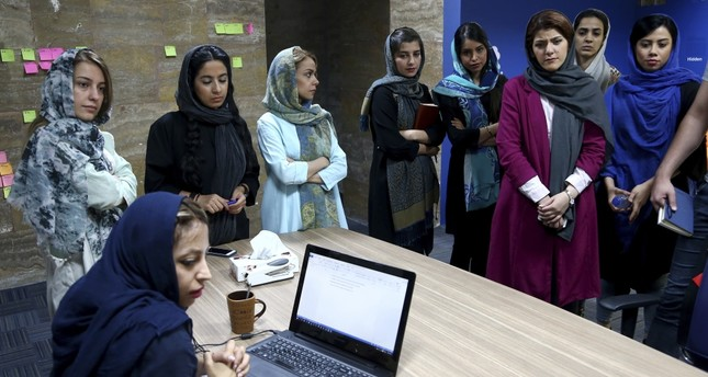 Staffers of the Bamilo online shopping site attend a meeting at their office in Tehran.