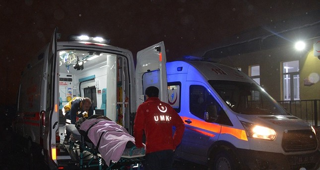 Paramedics take injured migrants to a hospital after minibus accident in Turkey's eastern Ağrı province (AA Photo)