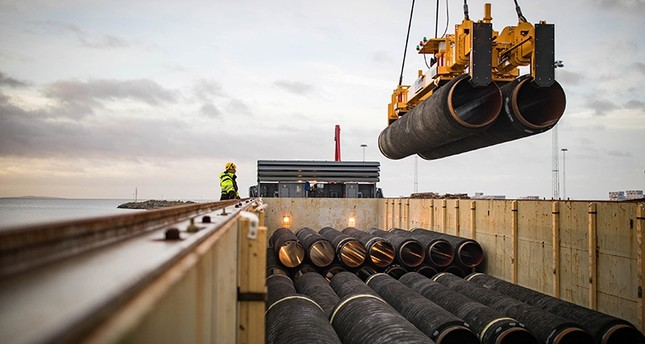 Pipes are loaded onto a vessel in the northern port of Mukran, on the island of Ruegen, Germany, February 28, 2018. (Reuters Photo)