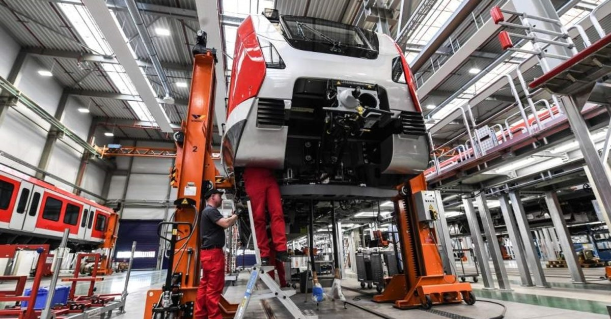 This file photo shows Bombardier employees working on an S-Bahn train at the Bombardier Transportation plant in Bautzen, Germany, May 13, 2019. (EPA Photo)