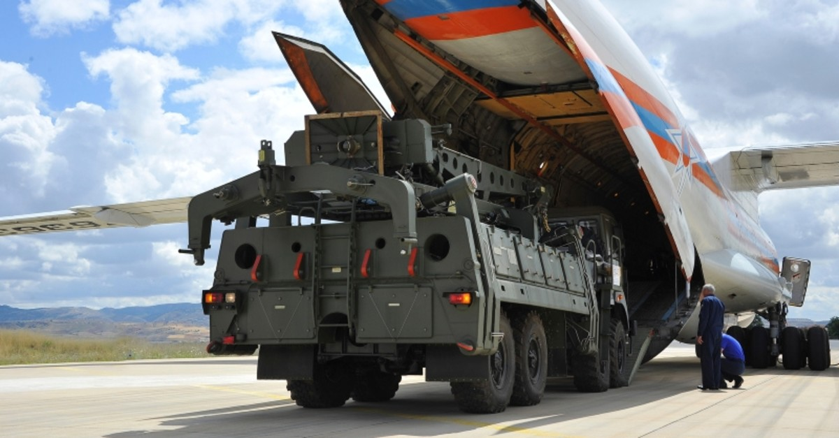 Military vehicles and equipment, parts of the S-400 air defense systems, are unloaded from a Russian transport aircraft, at Murted military airport in Ankara, Turkey, Friday, July 12, 2019. (Turkish Defense Ministry via AP, Pool)