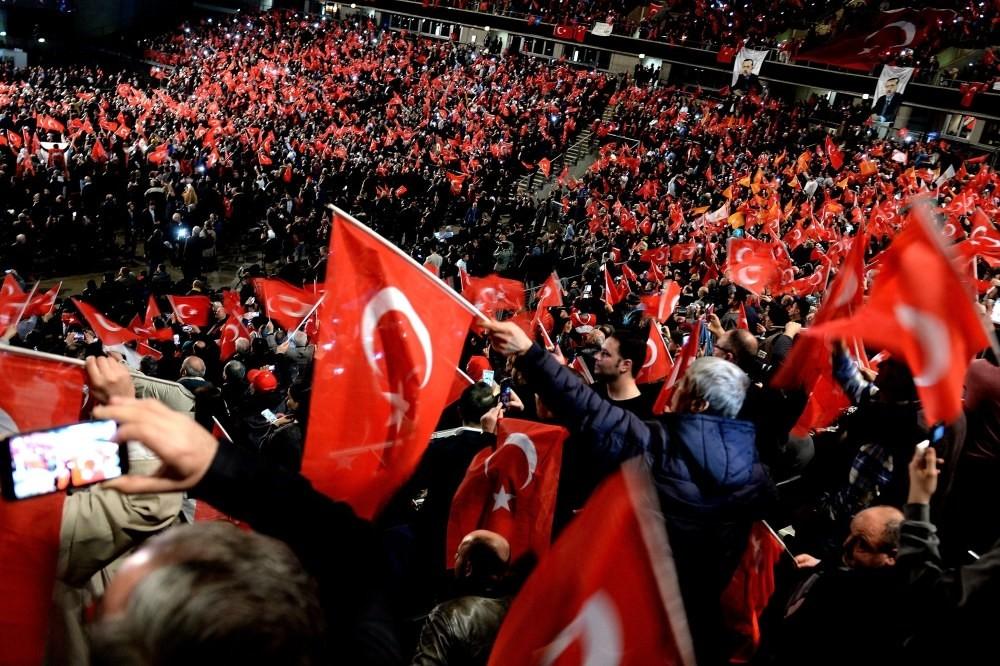 Participants waving Turkish flags at a meeting on the April referendum, held by Prime Minister Binali Yu0131lu0131ru0131m in Oberhausen, Germany, Feb. 18.