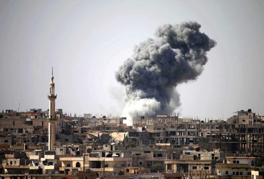 Smoke billowing in the distance following reported airstrikes on the southern Syrian city of Daraa, Feb. 22, 2017.