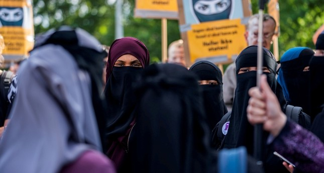 The group Kvinder i Dialog takes part in demonstration against the first fine given for wearing the face veil, niqab, in Copenhagen, Denmark August 10, 2018. (Reuters Photo)