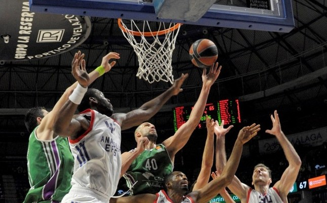 Unicaja's James Augustine (3-L) vies for the ball against Anadolu Efes' Bryant Dunston (2-L) and Derrick Brown (4-L) during the EuroLeague basketball game on Feb. 8.