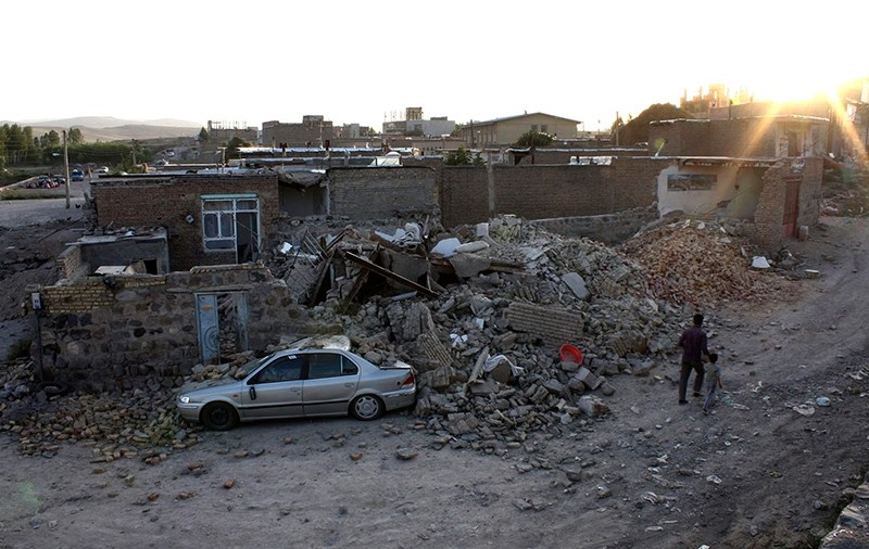 Ruins of a houses are seen after an earthquake in the city of Varzaqan in northwestern Iran, on Saturday, Aug. 11, 2012. (AP Photo)