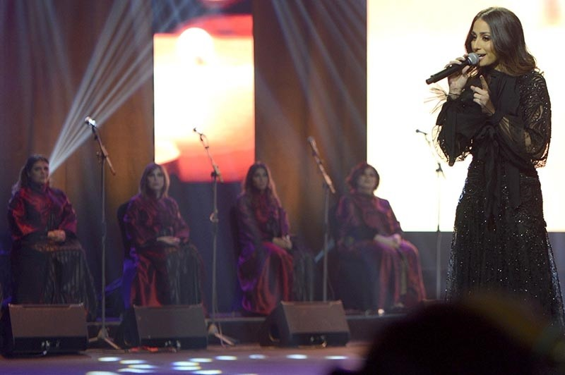 A picture taken late on Dec. 6, 2017, shows Lebanese singer Hiba Tawaji performing during the first ever female concert in the capital Riyadh at the King Fahd Cultural Center in the Saudi capital Riyadh. (AFP Photo)