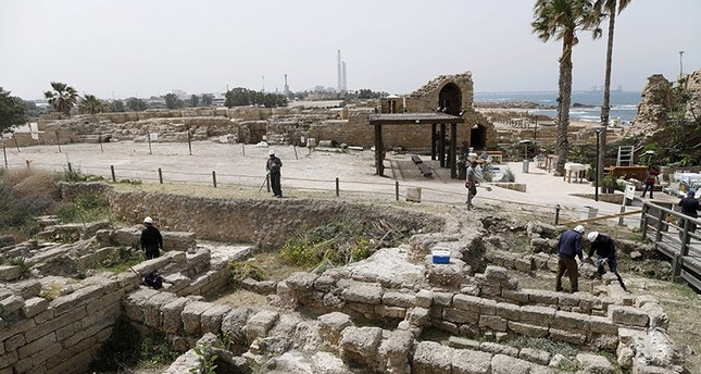 Workers of the Israel Antiquities Authority carry out conservation works at the restoration site of the ancient port of Caesarea, in Caesarea National Park, northen Israel, 26 April 2017. (EPA Photo)