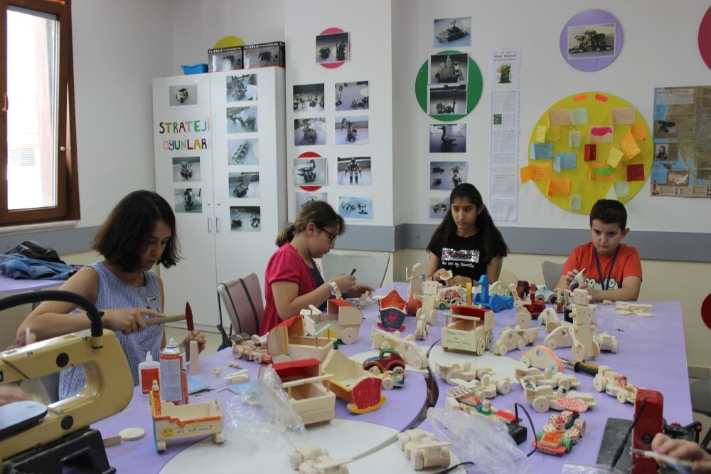 From cradles to cars, children build and paint wooden toys at the workshop.