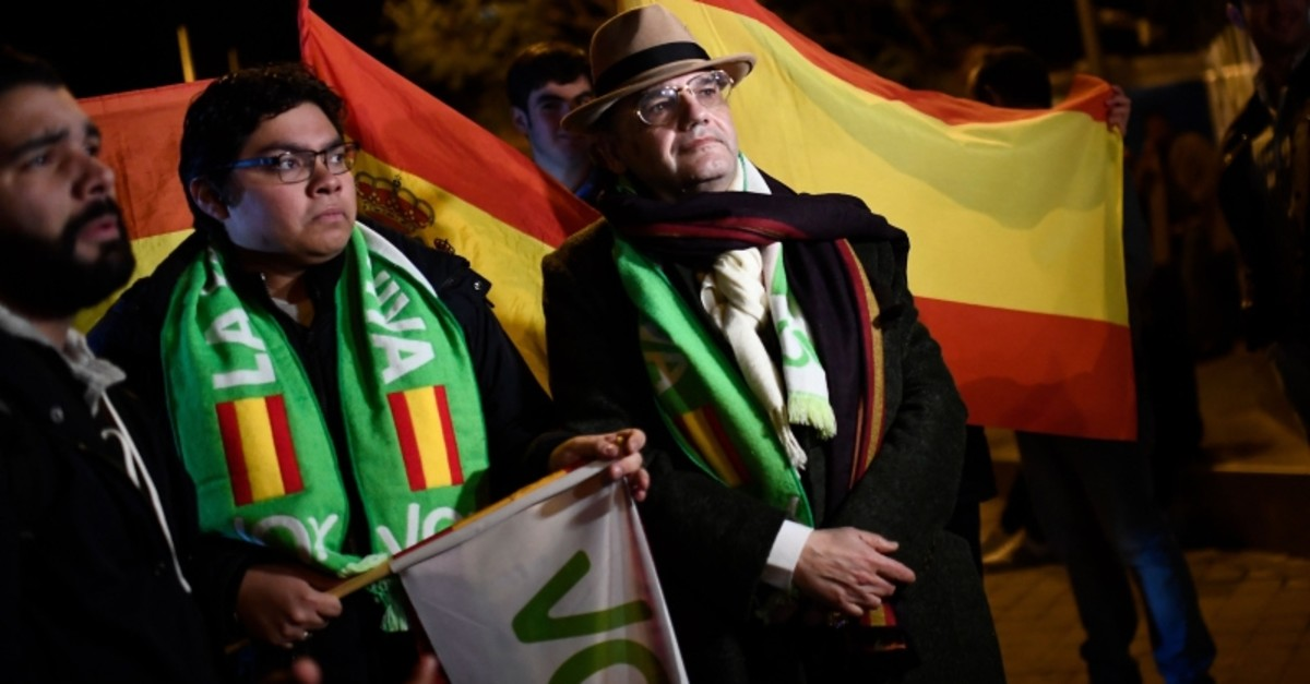 Supporters of Spanish far-right party Vox, hold Spanish flags as they gather outside the party's headquarters during the election night in Madrid on November 10, 2019. (AFP Photo)
