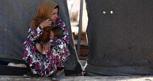 امرأة سورية في مخيمات النزوح في منطقة إدلب (الفرنسية)