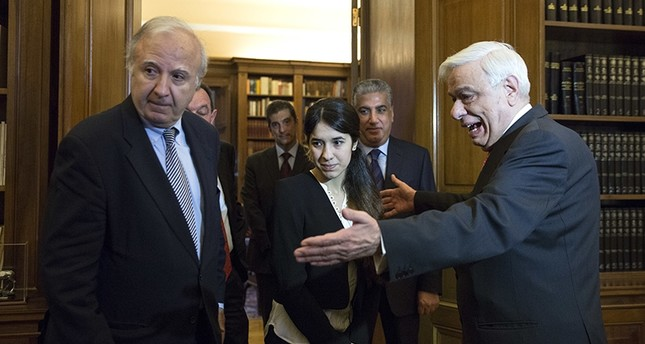In this Dec. 30, 2015 file photo, Iraqi Yazidi Nadia Murad Basee, center, is welcomed by Greek President Prokopis Pavlopoulos, right, before their meeting in Athens (AP Photo)