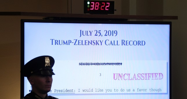 A U.S. Capitol police officer watches from in front of a video monitor displaying part of the call record of U.S. President Donald Trump's phone call with Ukraine's President Volodymyr Zelenskiy (Reuters Photo)