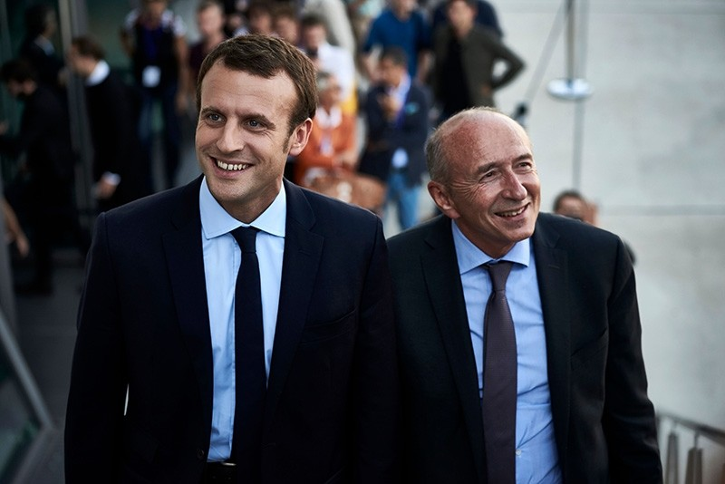 In this file photo taken on Sept. 24, 2016 then former French Economy Minister and founder of the political movement ,En Marche, (On the Move) Emmanuel Macron (L) and then Mayor of Lyon Gerard Collomb attend economics summit in Lyon. (AFP Photo)