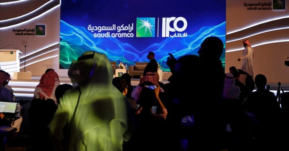 A sign of Saudi Aramco's initial public offering (IPO) is seen before the start of a news conference by the state oil company at the Plaza Conference Center, Dhahran, Saudi Arabia, Nov. 3, 2019. (Reuters Photo)