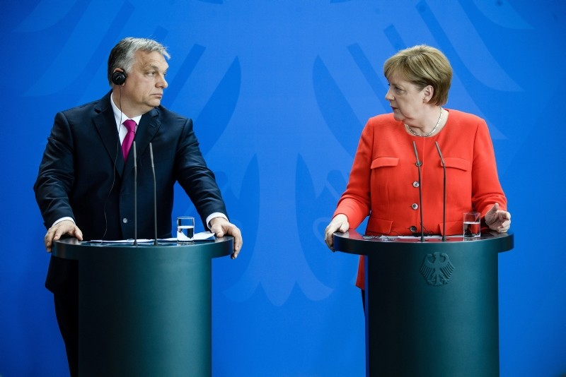 German Chancellor Angela Merkel, right, and Hungarian Prime Minister Viktor Orban address a joint press conference at the Chancellery in Berlin, Germany, July 5, 2018. (EPA Photo)