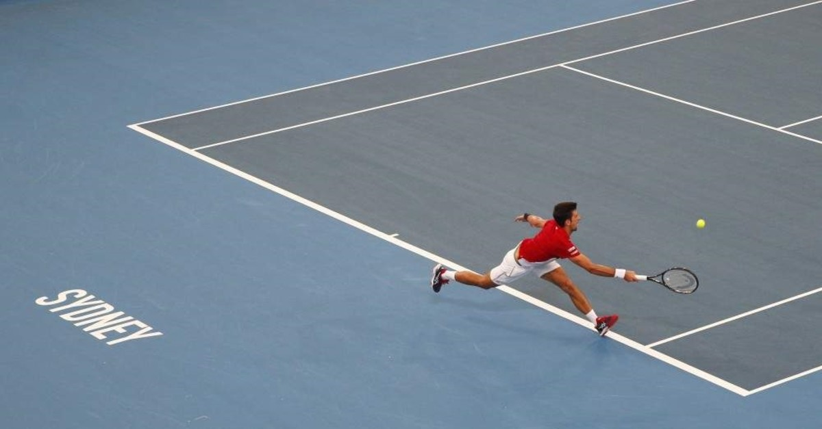 Novak Djokovic of Serbia plays a shot against Daniil Medvedev of Russia during their ATP Cup tennis match in Sydney, Saturday, Jan. 11, 2020. (AP Photo)