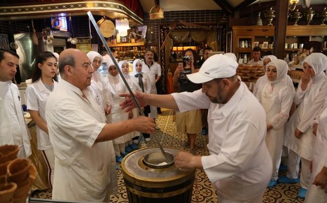 Maraş ice cream master Mehmet Sait Kanbur (L) teaches his pupils the finer details of how to make perfect ice cream.