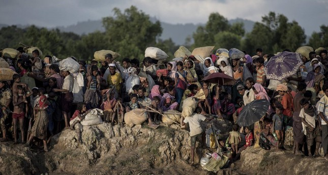 This file photo taken on October 09, 2017 shows Rohingya refugees wait after crossing the Naf river from Myanmar into Bangladesh in Whaikhyang on October 9, 2017. (AFP Photo)