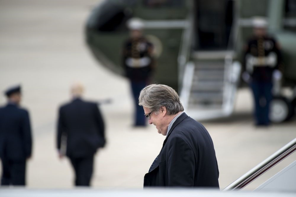 Steve Bannon walks off Air Force One as President Trump (2nd L) walks to Marine One at Andrews Air Force Base, Maryland, May 13.