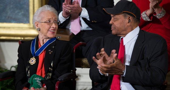 In a Nov. 24, 2015 file photo, Willie Mays, right, applauds NASA mathematician Katherine Johnson, after she received the Presidential Medal of Freedom from President Barack Obama during a ceremony in the East Room of the White House. (AP Photo)