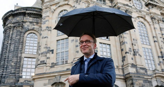 Germany's Deutsche Bundesbank President Jens Weidmann gestures in front of the Frauenkirche cathedral in Dresden. On Friday, the bank cut its growth forecast for German economy from 1.7 to 1.4 percent this year.