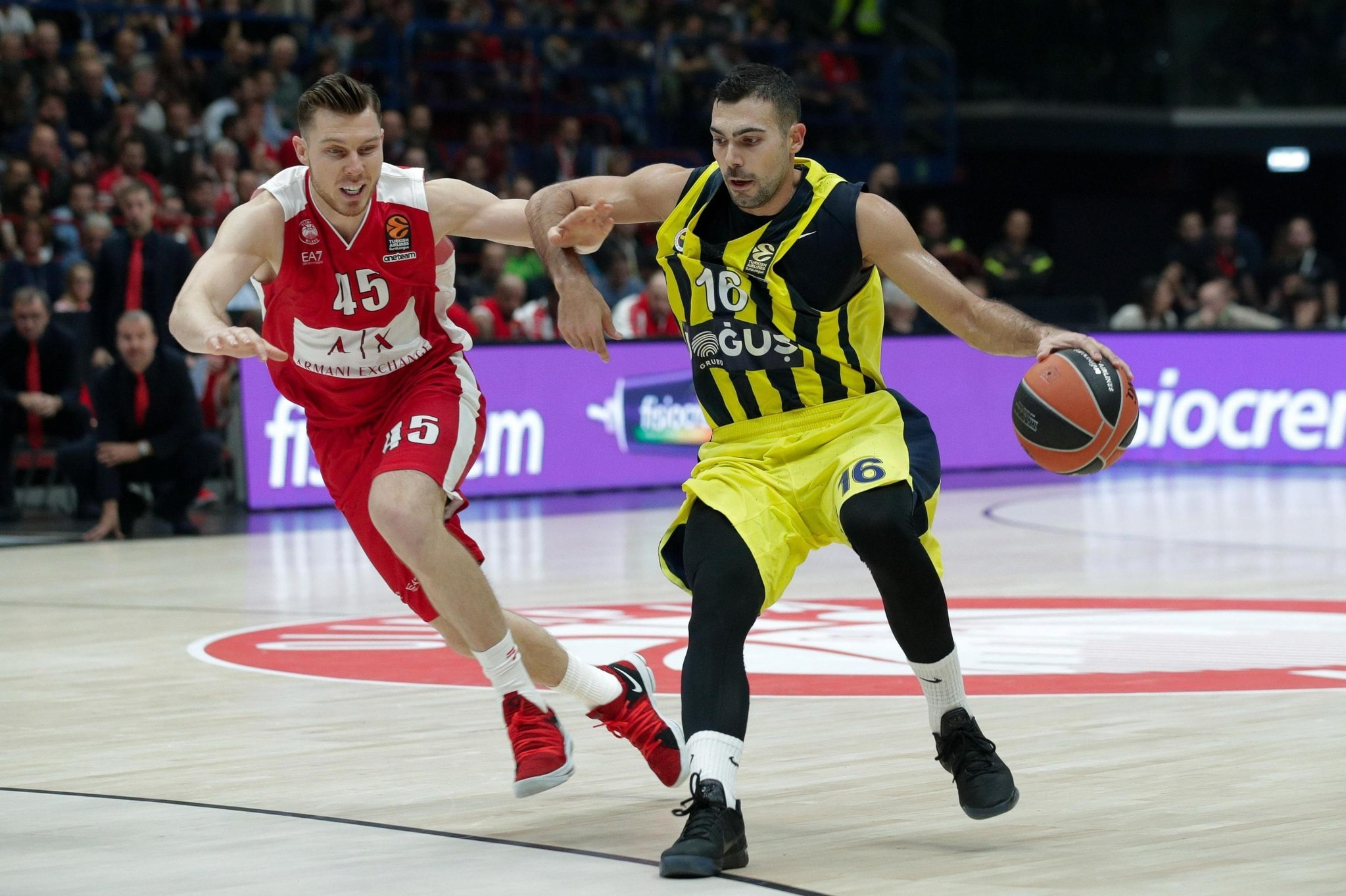 Dairis Bertans (L) and Kostas Sloukas in action during the Euroleague basketball match EA7 Olimpia Milano vs Fenerbahce Dou011fuu015f at the Assago Forum.