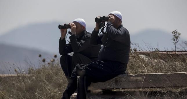 دروز إسرائيليون يراقبون المعارك على الطرف السوري للجولان