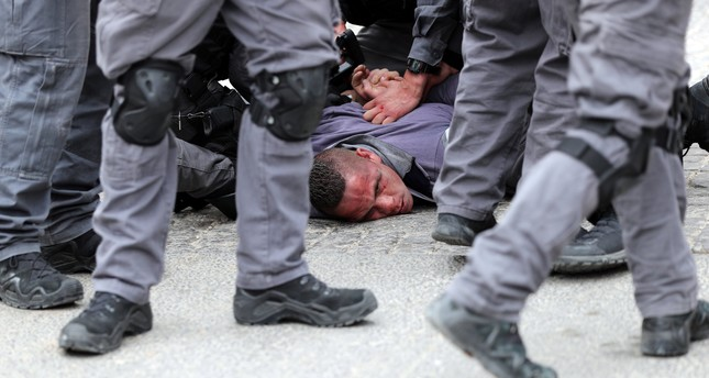 Israeli forces detain a Palestinian during scuffles outside the Al-Aqsa Mosque compound in Jerusalem's Old City, March 12, 2019.