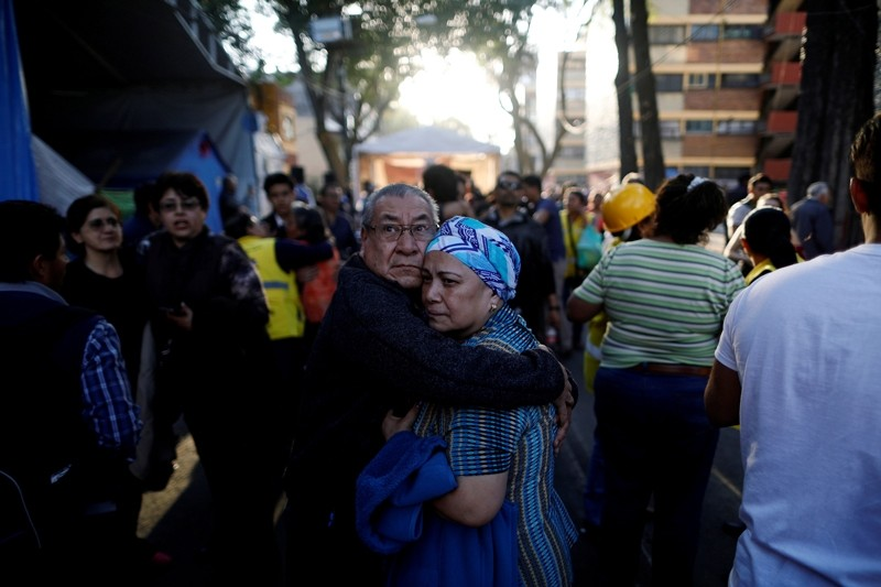 People react after an earthquake shook buildings in Mexico City, Mexico February 16, 2018. (Reuters Photo)