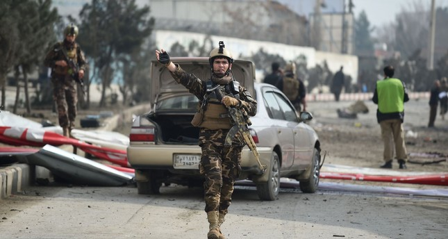 An Afghan security personnel gestures as he arrives at the site of a car bomb attack targeting a foreign forces, in Kabul on March 2, 2018. (AFP Photo)