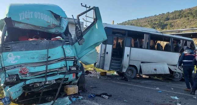Wreckage of damaged truck and shuttle minibus are seen after an accident in Bergama district, Izmir, on Feb. 13, 2020. DHA Photo