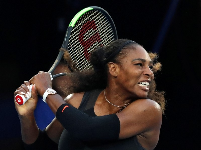 n this Jan. 28. 2017, file photo, United States' Serena Williams follows through on a backhand return to her sister Venus during the women's singles final at the Australian Open tennis tournament in Melbourne, Australia. (AP Photo)