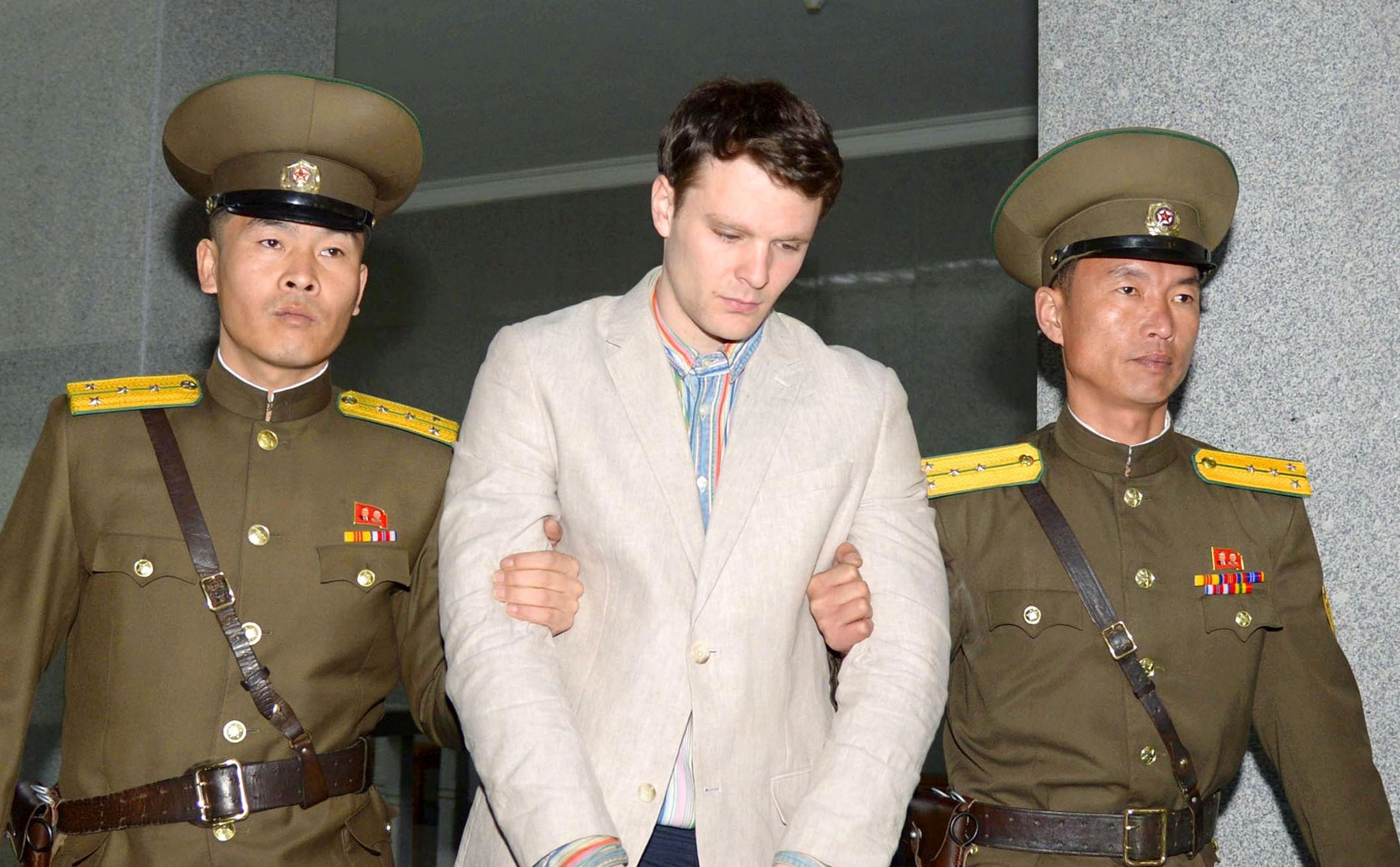 Otto Frederick Warmbier is taken to North Korea's top court in Pyongyang, North Korea, in this photo released by Kyodo March 16, 2016.