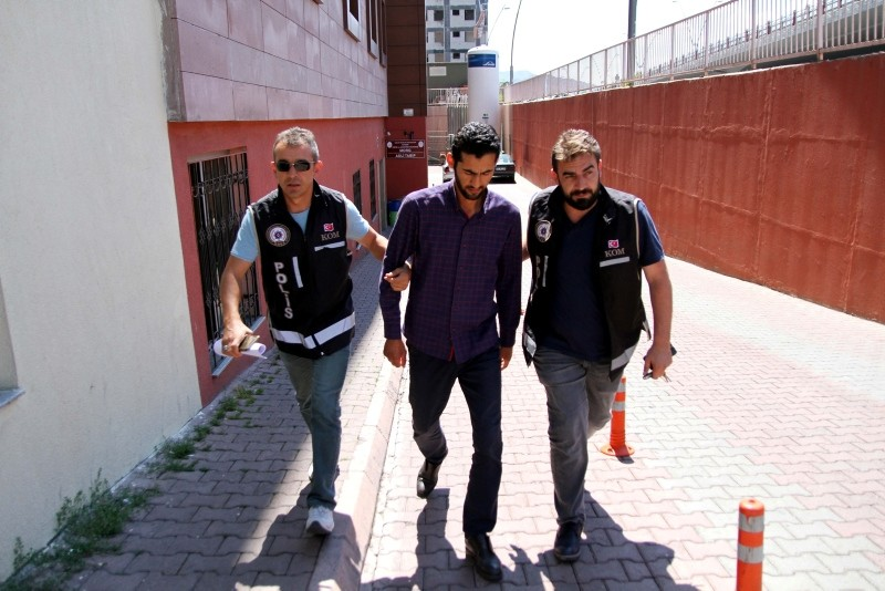Police officers escort a suspect in central Kayseri province. (AA Photo)