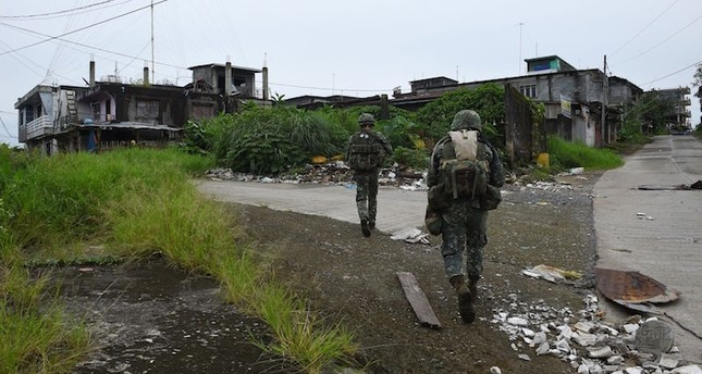 Philippine troops patrolling a deserted neighborhood in Marawi City in July 2017. AFP Photo