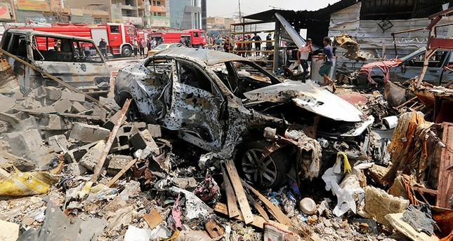 A destroyed car is seen at the site of a car bomb attack in Jamila market in Sadr City district of Baghdad, Iraq August 28, 2017. (Reuters Photo)