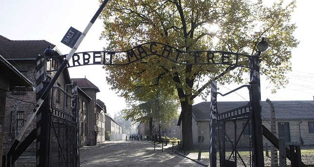 In this Oct. 19, 2012 file photo the entrance with the inscription Arbeit Macht Frei (Work Sets You Free) gate of the former German Nazi death camp of Auschwitz is pictured at the Auschwitz-Birkenau memorial in Oswiecim, Poland. (AP Photo)