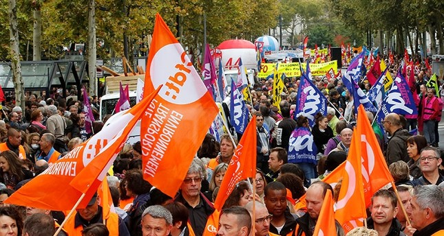 Public sector workers hold flags of the French Democratic Confederation of Labour union (CFDT) during a demonstration as part of a nationwide strike against French government reforms in Nantes, France, October 10, 2017. (Reuters Photo)