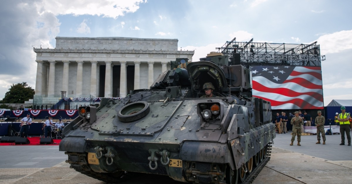 A U.S. Army soldier drives a Bradley Fighting Vehicle into position by the Lincoln Memorial, Washington, D.C., July 3, 2019.