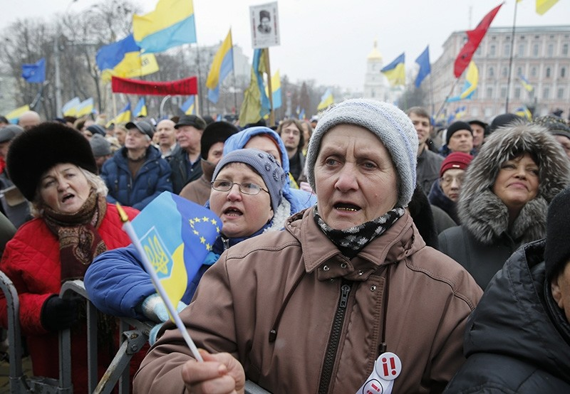 Protesters shout anti-Government slogans and demand the impeachment of President during their rally in downtown Kiev, Ukraine, Feb. 18, 2018. (EPA Photo)