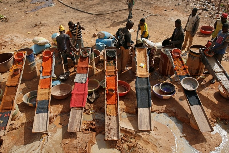 Artisanal miners sluice for gold by pouring water through gravel at an unlicensed mine near the city of Doropo, Ivory Coast, February 13, 2018.